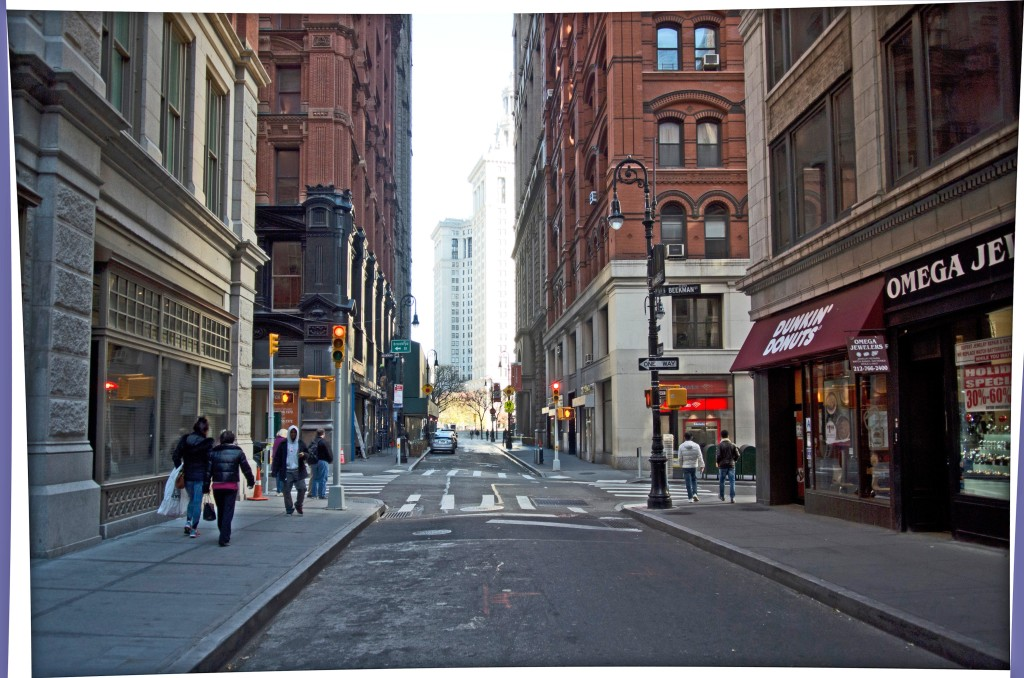 BEFORE: Nassau Street, looking towards Beekman Street and the the Municipal Building.
